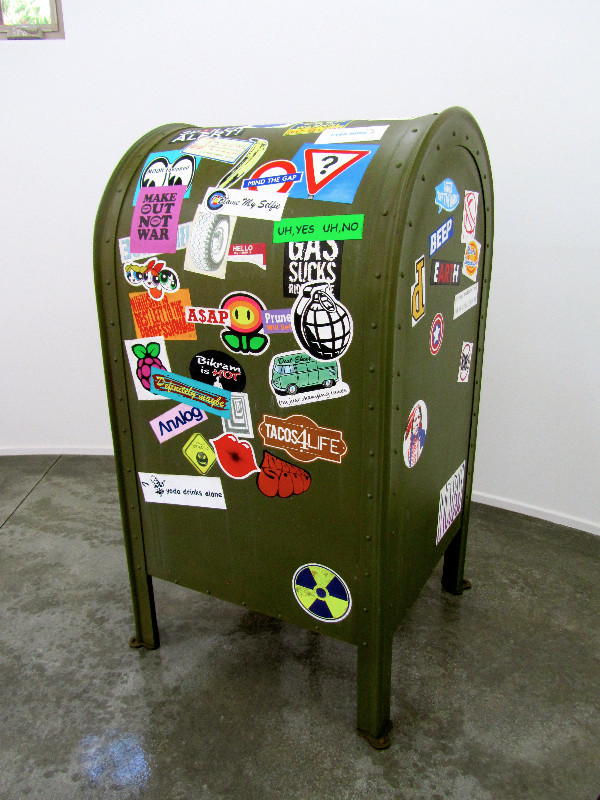 Relay Mailbox with Declarations, acrylic on canvas, composition woods, bondo, and tacks, 51.5 x 27 x 26 inches, $40,000